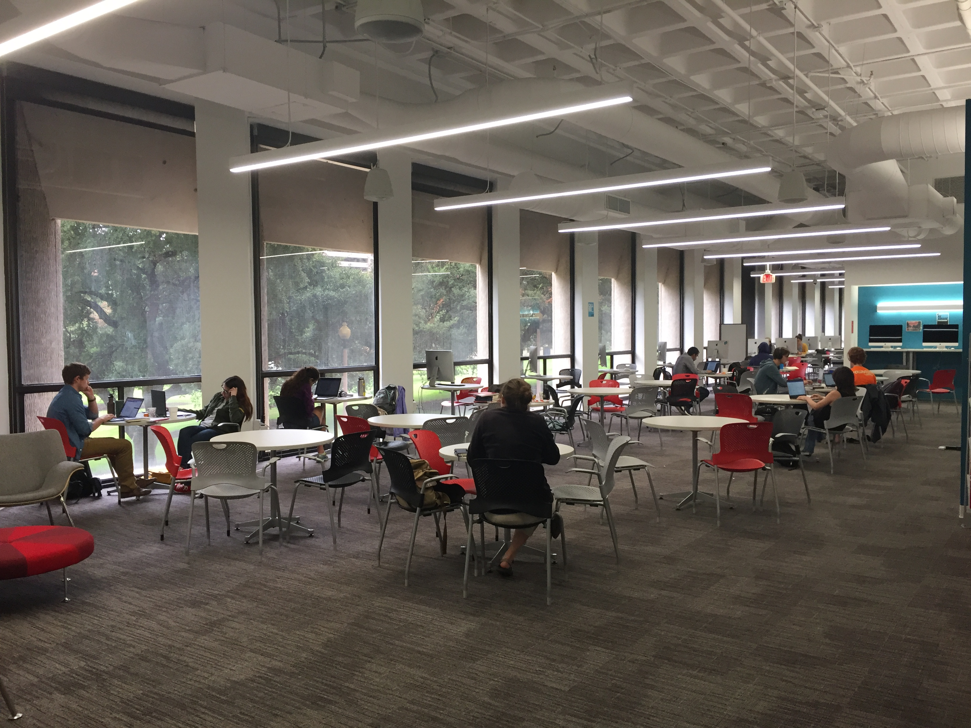 photo of students writing at the writing center