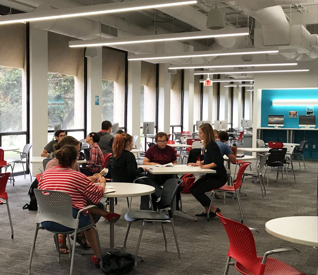 Students working with consultants in the Writing Center